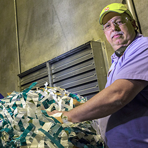 Factory worker preparing waste for recycling